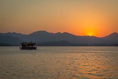 West Lake Sunset (Robert Borden) Tags: lake color orange yellow hangzhou westlake china asia canon canonphotos canonchina
