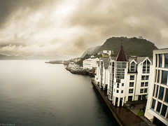 Dramatic sky in Norway (ea.leclercq) Tags: fisheye norway europe buildings architecture sea lake water dramatic sky clouds cloudy dark shadow mood moody mountain nature landscape travel tourist destination touristic cruise boat cruiseship