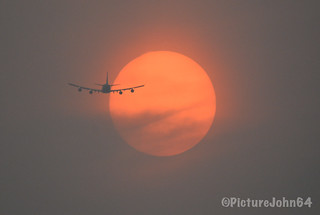 Air Bridge Cargo Boeing 747 (VQ-BHE) crossing an orange colored sun at sunset