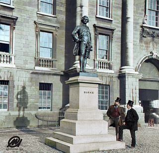 Two gentlemen admire the statue of Edmund Burke outside Trinity College Dublin,  21 April 1868.