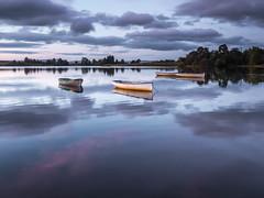 Loch Rusky (burnsmeisterj) Tags: olympus omd em1 sunrise scotland trossachs lochrusky boats loch reflection