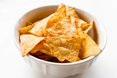 Tortilla Cheese Chips (wuestenigel) Tags: chip sauce crisp nacho appetizer eat background orange hot mexico corn food spicy pile salty isolated horizontal white crispy restaurant party fried mexican potato salsa tasty snack tortilla crunchy fast chips salt cuisine meal lunch nachos heap nobody yellow cheese crisps