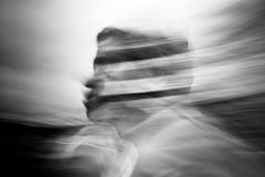 Ο Αίολος (ChrisRSouthland (on/off, away for work)) Tags: monochrome bw blackandwhite blackwhite mmonochrom elmarit28mmf28 streetphotography streetportrait mythology god wind greekgod greece blur motionblur longexposure