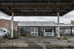 Closed Down (Number Johnny 5) Tags: tamron d750 2470mm decay garage reflections space empty mundane commercial urban great banal grim closed car yarmouth deserted nikon overgrown taxi documenting grot