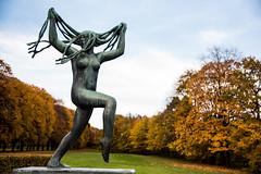 DSC_8781 (Maryna Beliauskaya) Tags: statues oslo norway autumn trees girl woman hair park grass statue tree sky