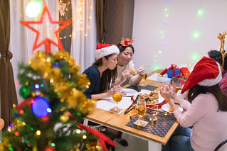 Young friends enjoying Christmas party at home