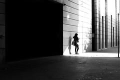 Next to the dark door (pascalcolin1) Tags: paris13 femme woman ombres shadows lumière light téléphone phone porte door obscure dark photoderue streetview urbanarte noiretblanc blackandwhite photopascalcolin 5omm canon50mm canon