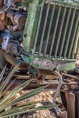Solitaire Garden Feature (gecko47) Tags: garden plants rocks tractor fordson decoration roadhouse cafe fuel solitaire namibia khomas derelict scrap
