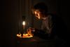 A Light in the Dark (Robert Bauernhansl) Tags: light licht dark darkness hell dunkel wax wachs glühbirne seilzug cablepull orange face gesicht installation mediaart arselectronica arselectronicafestival beleuchtet illuminated waxbath linz austria upperaustria man person domasschwarz wachstropf waxdrop