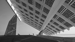 Under a photovoltaic system (gerard eder) Tags: world travel reise viajes europa europe españa spain spanien städte stadtlandschaft barcelona city ciudades cityscape cityview cataluña bw blackandwhite blackwhite sw nikon paisajes photovoltaic solarenergy bicycle architecture architektur arquitectura