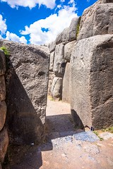 Huge rocks at Saqsaywaman archeological site.  See my smartphone on the ground to give you an idea of the size?
