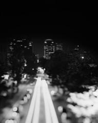 Urban fold (Zeb Andrews) Tags: linhoftechnikaiv ilfordhp5 maybeithinkso portland oregon urban cityscape tiltshift longexposure night nightphotography 4x5 pacificnorthwest monochrome filmphotography lighttrails silverhalide zaahphoto needtodomoreofthis city pdx portlandoregon blur bokeh scannedatbluemooncamera epsonv700