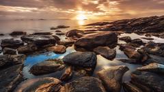 Rocks and Golden Light (Kurt Evensen) Tags: landscape sunset nature leefilter reflections le rockyshore weather rocks norway longexposure golden cottonwaves sky seascape sea rogaland shore smooth