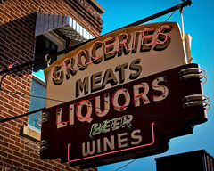 Meats & Liquors (Pete Zarria) Tags: meat groceries liquor wine whiskey beer party neon sign red green old