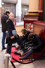 IMG_2645 Shoe shine (roger_thelwell) Tags: leadenhall market shoe shine liverpool street uk london beautiful photography bw black white portrait people urban city commuters winter cold hat hats mobile phone cell england hair fleet strand life natural walking talking conversation chat speak speaking beauty handbag stud studs lamppost lamp post shiny shiney leather smoking cigarette westminster traffic cab taxi bag sac shoulder mono monochrome great britain streets photographs real photographic photos candid