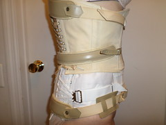 Side View of Back Brace with Corset (KAFOmaker) Tags: brace braces braced bracing leather metal afo scoliosis back control strap straps strapped strapping orthopedic orthopedics girl cuff cuffs cuffed corset
