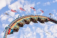 Looping (brev99) Tags: d610 oktoberfest ride amusementpark fair people flags clouds tamron70300vc ononesoftware on1photoraw2017