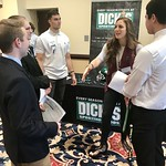 Students talking to Alumni at the professional networking symposium