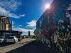 Too Blue (Steve Taylor (Photography)) Tags: jacob yikes fromthegroundup art graffiti mural streetart building blue newzealand nz southisland canterbury christchurch cbd city lensflare autumn sky cloud sun sunny sunshine bluesky
