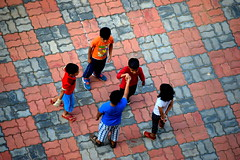 Friends again !  Shake hands and forget the past !               The G-5 Summit !! (Sriini) Tags: children boys girls friends forget play g5 summit games street candid photo photography shake hands girl kids colorful color tiles topview streetphotography