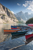 Canoes At Moraine Lake (steveholding8) Tags: canada morainelake alberta lake mountains banffnationalpark canoes boats steveholding
