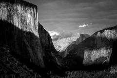 La Ventana (Amar Raavi) Tags: tunnelview wawona yosemite nationalpark mountains granite elcapitan halfdome valley trees green sunset clouds iconic scenic expansive overlook dramatic historic anseladams landscape outdoors travel california usa thewindow blackandwhite monochrome shadows light