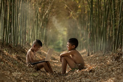 Asian two boys playing laptop at Countryside,Finding Notebook Computer Knowledge in Rural Asia. (Visoot20) Tags: asian laptop study indonesia computer people using thai phone child kid person happy two boy school poor thailand tablet fun internet business online conference vietnam children countryside lifestyle happiness looking communication play outside outdoor asia nature working learn notebook games learning background sitting freedom joyful enjoy myanmar laos outdoors white