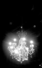 LeicaIIII_Summar_TriX_076Chandelier (Johnny Martyr) Tags: chandelier light lights rich wealthy class classy dark darkness lightfixture classic retro hip modern vintage rangefinder 35mm film bw grain kodak leitz summar glow leicaglow hilation glare flare aberration white black reception dance hall 1930
