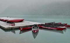 Silent Canoes, Lake Louise (tvdflickr) Tags: lakelouise banffnationalpark canada canoes lake snow frost photobytomdriggers thomasdriggersphotography tvdimages reflection lumix lx100 panasonic banff tranquility serene leicalens lumixphotography