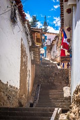 Steep, narrow steps to access some homes in Cusco.