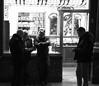 It Came From Above (Ren-s) Tags: blackandwhite bnw black blackwhite white city ville bruxelles brussels belgique belgium belgian belge contrast new street streetphotography rue photographiederue noir noiretblanc noirblanc blanc nb bw people personnes groupe group man woman night nuit europe canon eos 600d 1750mm men hommes looking regarder téléphone portable gsm phone smartphone heads têtes boutique frame shop window fenêtre light lumière sigma