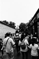 "Crowded Guozijian street, Beijing (Xsbmrnr (Please read profile before ""following"") Tags: gentrification crowds people film beijing china chinaimages blackandwhite bandw blazinal 400film 35mmfilm 35mm jch400streetpan ishootfilm olympusom1 olympus om1 hutong"