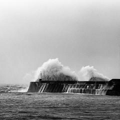 Lighthouse vs wave (Cariadus) Tags: hasselblad 500elm film rollfilm 6x6 120 analog analogue blackandwhite bw selfdeveloped ilford delta400 xtol jobo cpe2 porthcawl storm waves stormbrian bridgend