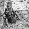 Snack (gecko47) Tags: child bw blackandwhite eating porridge cornmeal himba village namibia kamanjab visit hereroheritage cattleherders kaokoland himbaboy