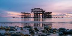 Sunset at Brighton's West Pier (hehaden) Tags: pier westpier ruin ruined sea beach sand pebbles lowtide sunset brighton sussex sel1670z