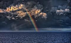 Rainbow over the ocean, during rain storm- HDR (dgoldenberg52) Tags: cloud rainbow view storm high dynamic range hdr