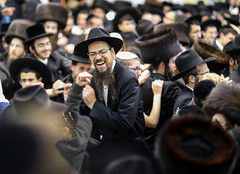 """""""As we laughed there, we didn't cry for years"""" (Meir Ariel) (ybiberman) Tags: israel jerusalem meahshearim suckot simchatbeithashoeivah rejoicingofthewaterdrawinghouse man ultraorthodox jew beard hat dancing celebrating happy portrait candid streetphotography"""