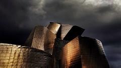 Storm at the Guggenheim (Luc1659) Tags: bilbao spagna guggenheim museo nuvole notturno oro arte platinumheartaward