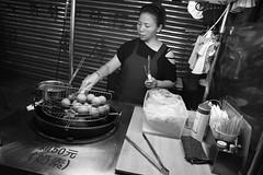 Taro Balls Lady (superzookeeper) Tags: nightmarket 5dmk4 5dmkiv canoneos5dmarkiv ef2470mmf28liiusm eos digital taiwan hsinchu monochrome bnw blackandwhite tw formosa market people streetfood night street taroballs lady over1000views