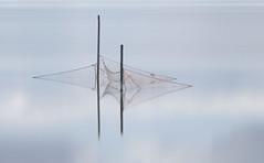 Visnetten (Duevel) Tags: visnetten reflection reflectie water fishingnets fz2000