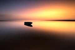 Sundown on the wild coast... (Grégory Dolivet) Tags: sunset cloud boat beach water sea light longexposure seascape sky sun soleil skyporn ciel coucherdesoleil cloudy cotesauvage wildcoast weather