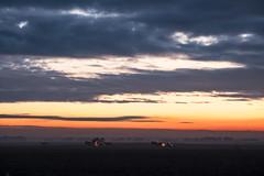 Early harvest (Medienlümmel) Tags: agriculture tractor field sunrise earlymorning dramatic brandenburg fujifilmxt2 clouds fieldfarming harvest foggy xf55200mmf3548rlmois