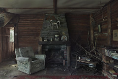 Cabin Fever (andre govia.) Tags: abandoned andregovia cabin log creepy horror haunted house fireplace chair wood woods decay decayed derelict dead decaying decayedbuildings photo offlimits
