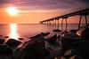 Petrol bridge (Lluvia Fotografia) Tags: bridge sunset rocks sea canon flickr 1585 long exposure larga exposición barcelona sol playa puente rocas