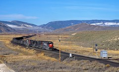 With clean exhaust over the stacks SP 8594 leads a coal train past Troublesome siding, April 6, 1995. (rolfstumpf) Tags: usa colorado troublesome southernpacific moffatroad emd sd40m2 landscape rockymountains railway railroad sp8594 coaltrain trains mamiya fujichrome provia