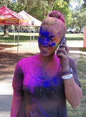 Blue in the Face, Holi Festival (moonjazz) Tags: humor face portrait woman color photography female festival holi funny puple pink blue phone pretty smile celebrate call laugh sacramento girl happy creative imagination her wild wacky dazzling hair shirt messy fantasy