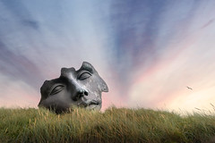 Face in the Sky (ShanePix) Tags: bird sunset face sculpture portrait portraiture hague netherlands blue magichour igormitora museum woman scheveningen outdoor sureal color red eyes eye europe travel sea thehague