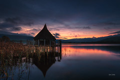 Crannog Lake Sky Fire (Geoff Moore UK) Tags: dawn sunrise lake water wales crannog reflections mountains daaybreak calm cool warmtones clouds rain storm morning dawning nature outdoors outside adventure