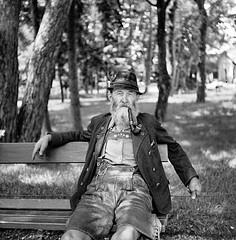 LetterBox0026.jpg (The Digital Shoebox) Tags: german monochrome man negative blackandwhite outside bench outdoors pipe smoking park portrait hat film sitting