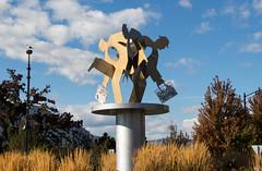 Running Man sculpture, Kelowna (amanda & allan) Tags: kelowna britishcolumbia canada runningman sculpture marionleajamieson downtown roundabout clouds sky